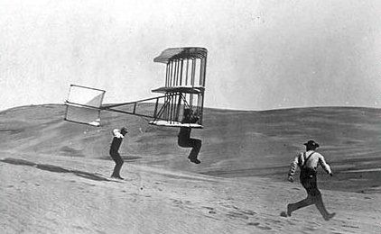 "Herring tests the Chanute's ""oscilating wing"" glider at the Wright brothers camp in Kitty Hawk, NC in 1902."