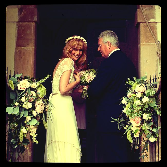 Kelly Reilly and her father waiting to enter the wedding ...