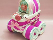 Windeltorte stubenwagen schnullerkette in rosa diaper cakes