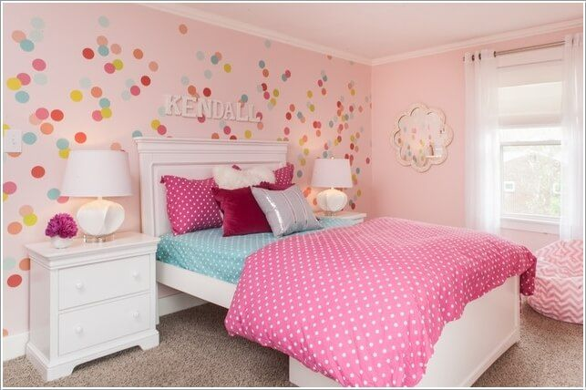 pretty pink wall with colorful circles decals and lovely flower mirror ideas for childrens room along with big bed and drawers also lovely lamps and sheer