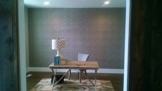 Wallpaper makes a statement in this minimalist office.