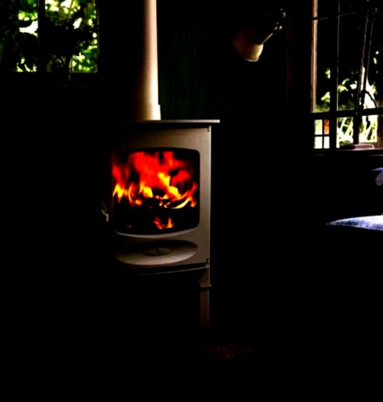 fuel stove with an output of 49kw on display within our s A small wood or solid fuel stove with an output of 49kw on display within our s A small wood or solid fuel stove...