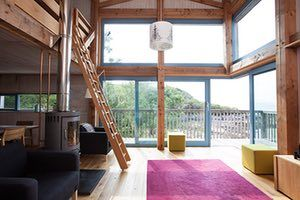 Homes - On The Rocks: living area with mezzanine level
