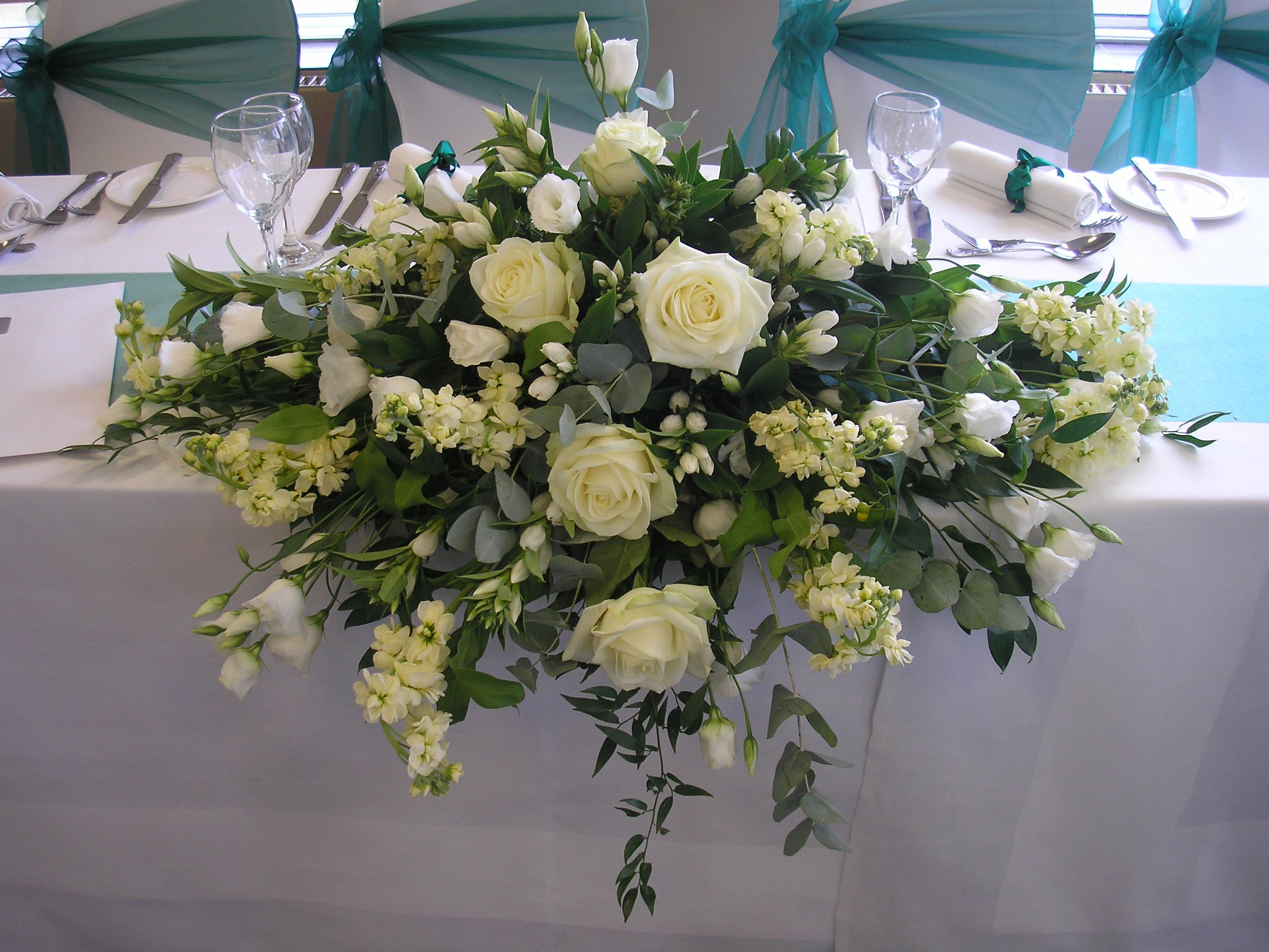 Top table display of Roses, Stocks, Lisianthus and eucalyptus.