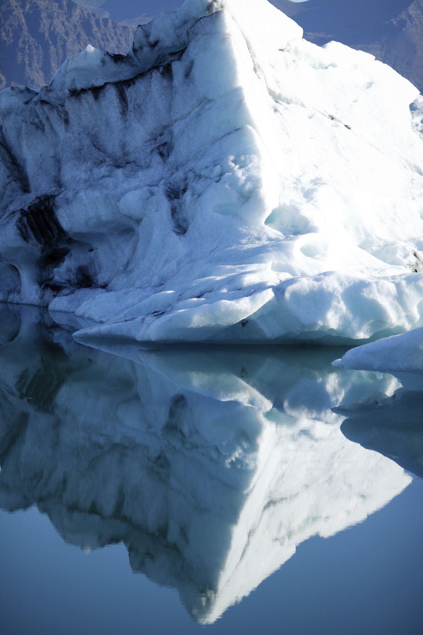 Love the reflection of this large iceberg in Jokulsarlon Glacial Lake, Iceland