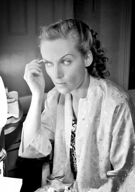 Carole Lombard applying makeup