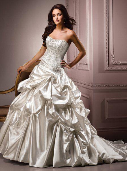 Gorgeous soft shimmer satin wedding dress by Maggie Sottero.