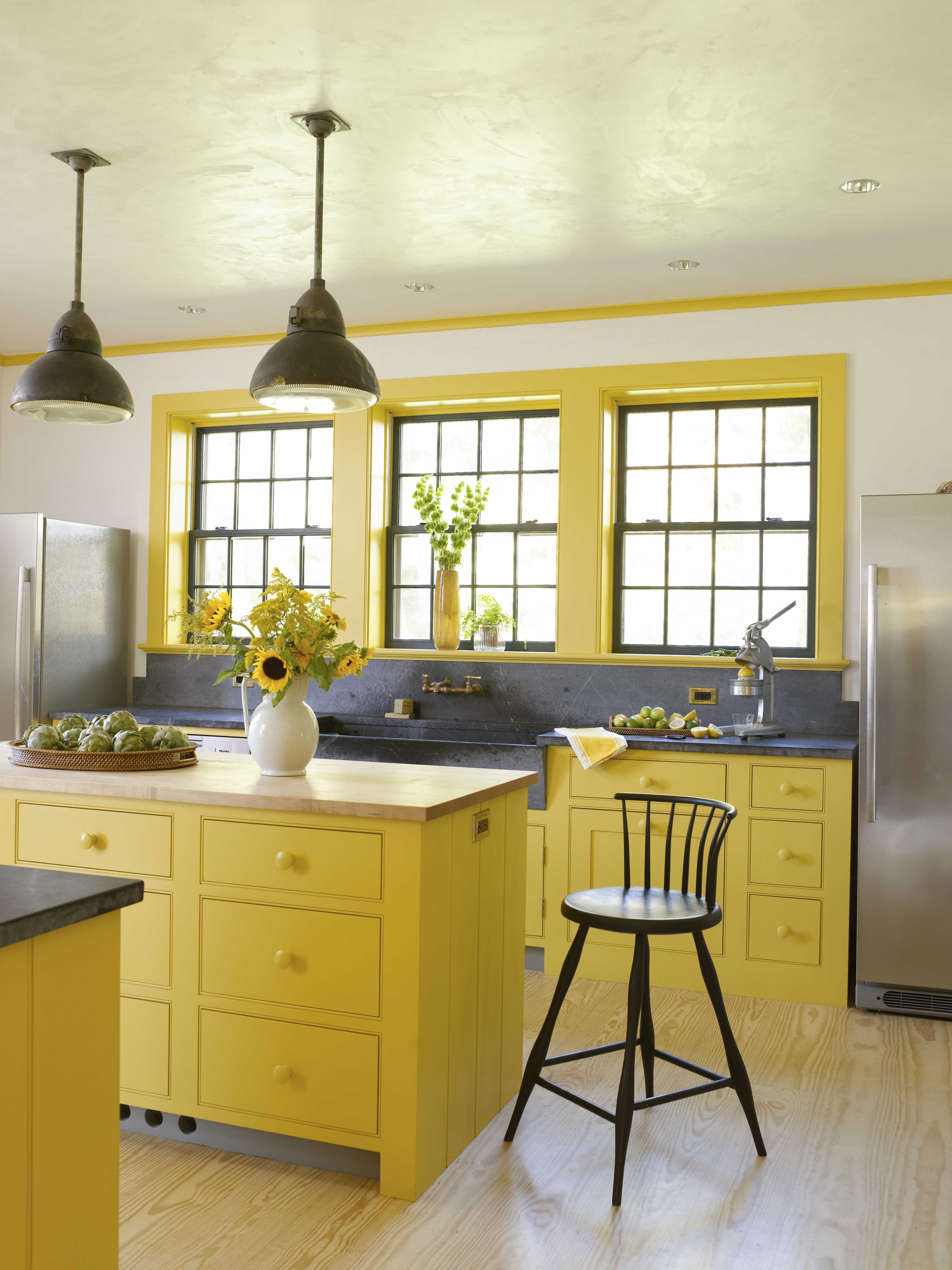 Traditional kitchen with soapstone sink vintage lighting yellow