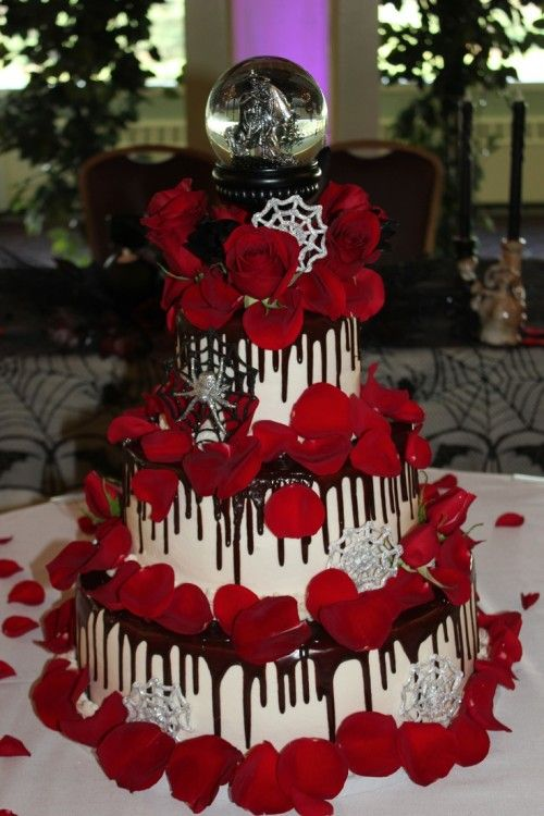 For a wedding during the halloween holiday, a creative cake is a ...