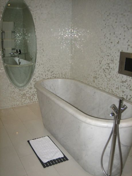 Penthouse Suite bathroom with marble bath - http://www.gucciwealth.com/penthouse-suite-bathroom-with-marble-bath/
