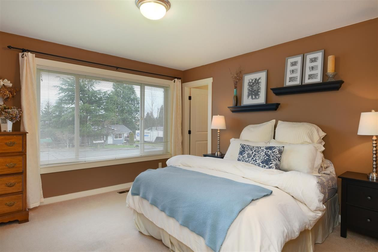 Love the color combination on this master bedroom. Fancy