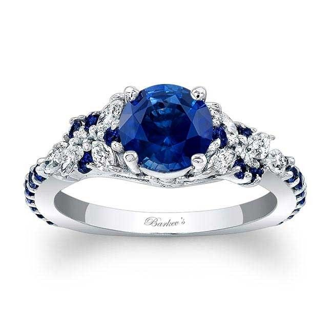 Barkev's Blue Sapphire Engagement Ring BSC7932LBS   Barkev's - Sapphire engagement ring blue, Blue engagement ring, Vintage engagement rings, Engagement rings sapphire, Blue sapphire rings, Sapphire engagement - An exquisite blue sapphire and diamond engagement ring, featuring a white gold shank with a prong set round blue sapphire center  The cathedral shoulders are adorned with marquise cut diamonds artfully arranged, while small round, shared prong set, blue sapphires accent the shoulders and shank for an elegant touch of glam
