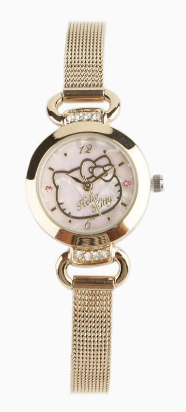 07d8c5aed This Hello Kitty watch features a pale pink pearlized face with simple Hello  Kitty motif.