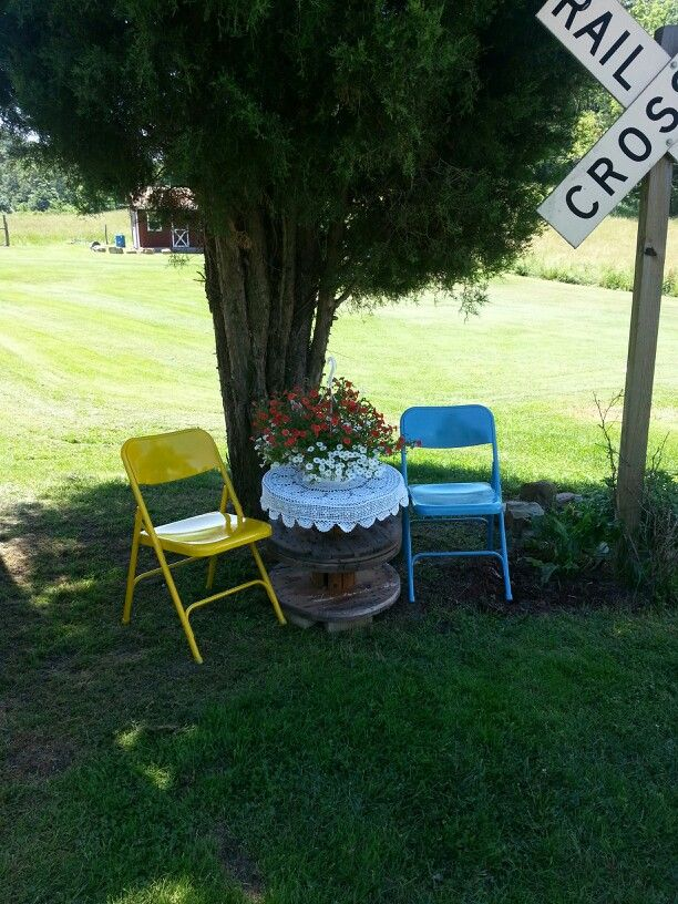 Repurposed chairs and wooden spools | Cow print chair ...