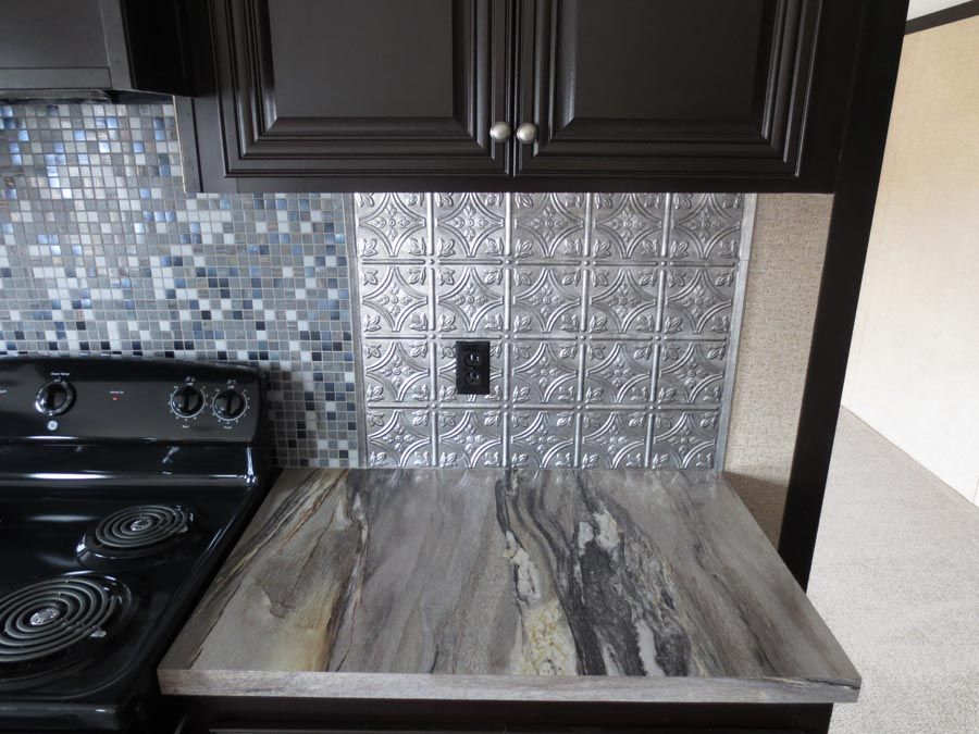 The Formica Dolce Vita Laminate Countertop With A Gorgeous Thermoplastic Metallic Backsplash