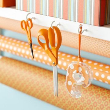 Perfect for the sewing room - use cup hooks attached to my cutting table, sewing table, or shelf to store scissors, tape, etc.