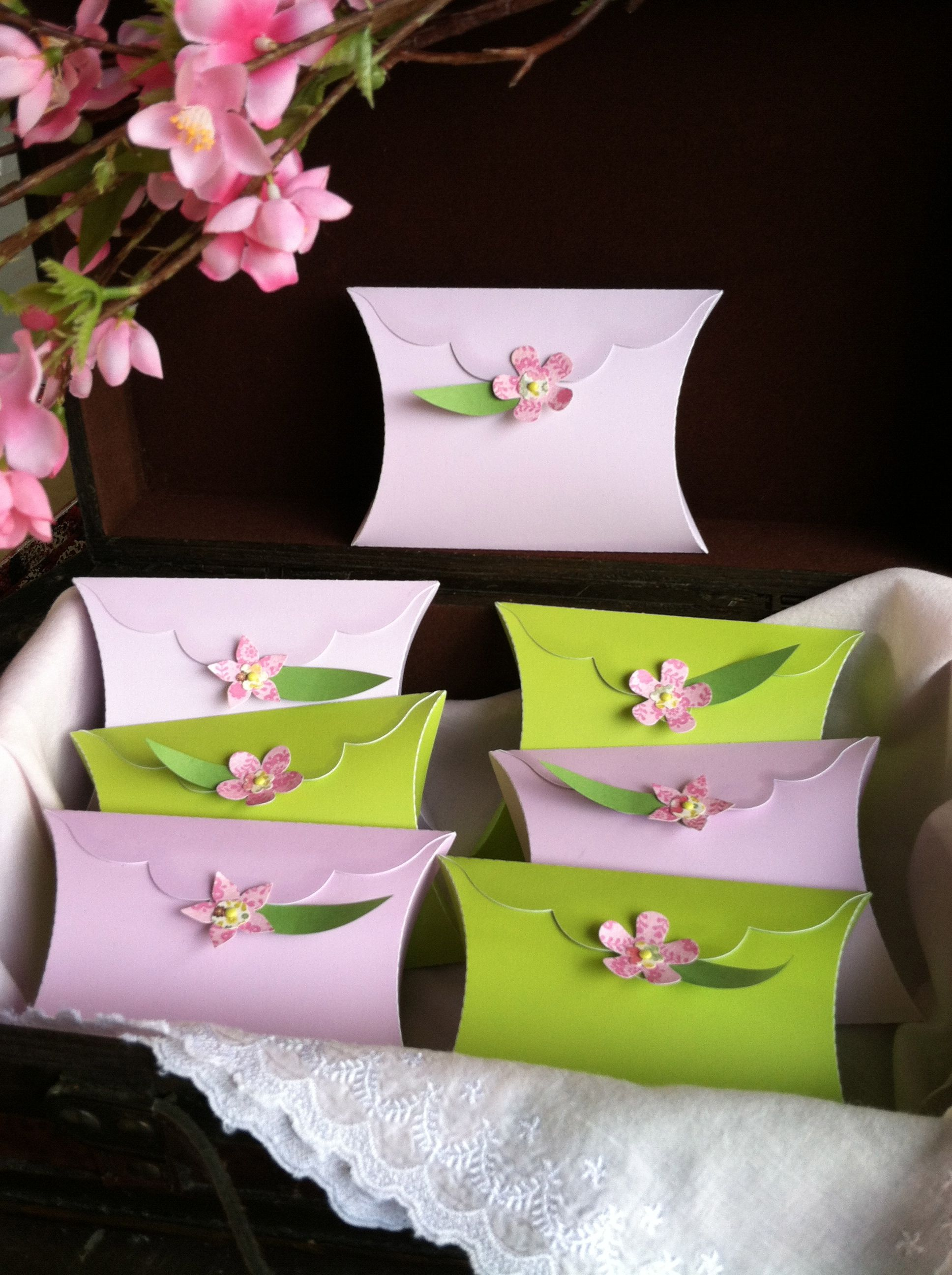 The DIY cherry blossoms look great on the pillow boxes too!