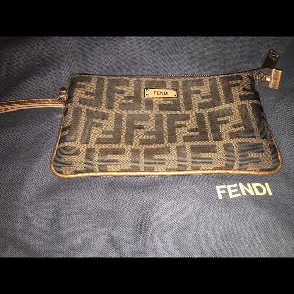 Fendi zucca Wristlet Fendi zucca Wristlet perfect for night wear good condition comes with box FENDI Bags Clutches & Wristlets