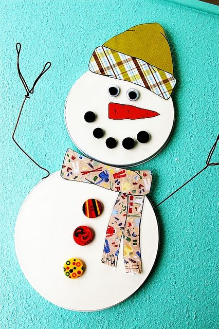 So clever! Magnetic Snowman made out of burner covers.
