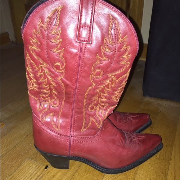 Cute red cowboy boots Who wouldn't want an great pair of red cowboy boots? These adorable boots have been worn maybe twice. As you can see by the picture they are in perfect condition. Brand: Laredo Laredo Shoes