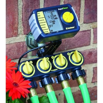 Melnor 4 Zone Watering System 558 219 The Home Depot Automatic Watering System Garden Irrigation System Garden Irrigation