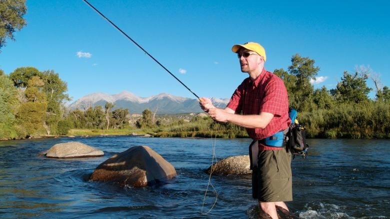 A man fly-fishes on the Arkansas River - near Salida, CO