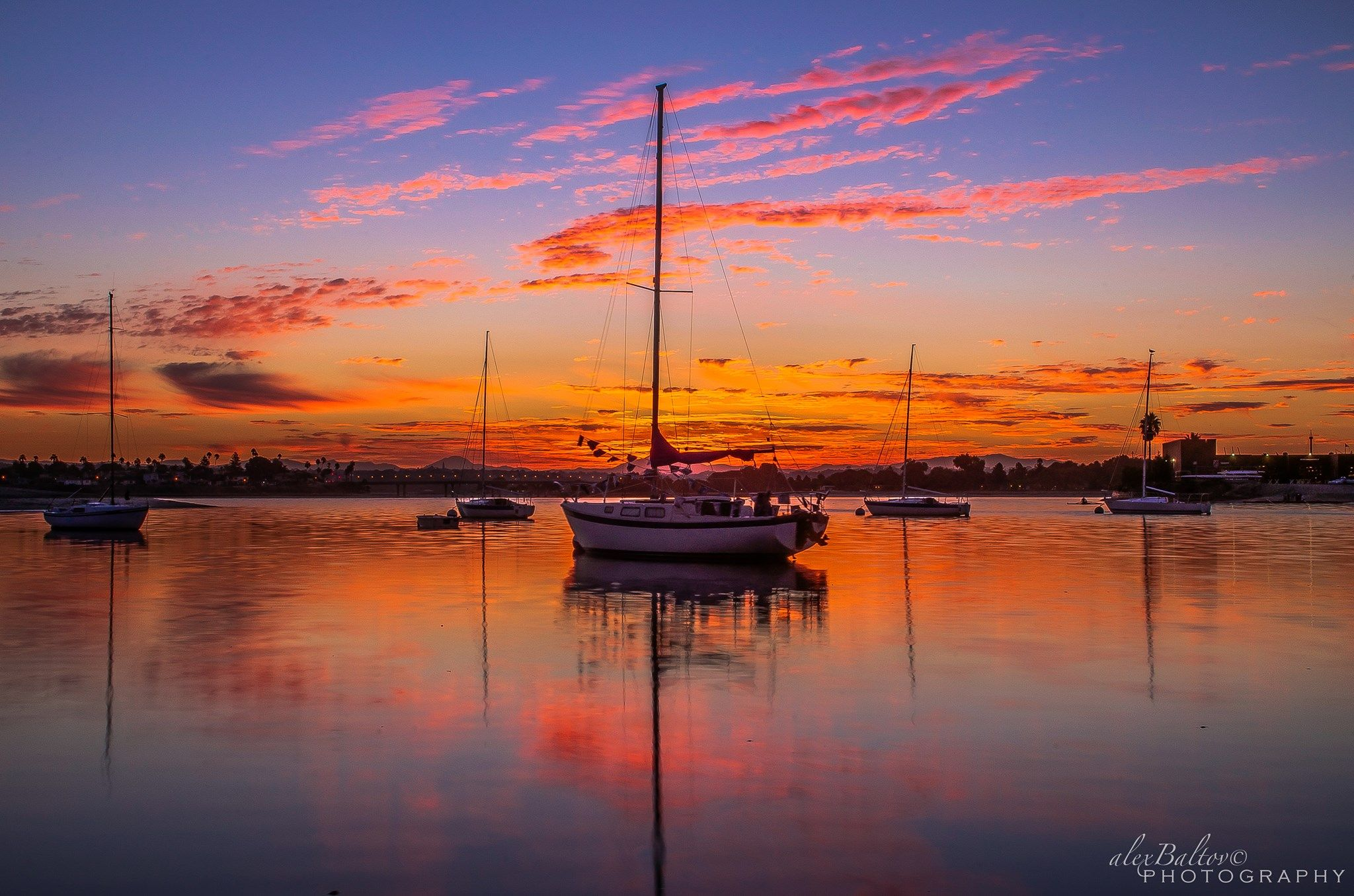 The recent sunrises here over the past week here in San Diego have been pretty intense... Pretty on the Bay...  Alex Baltov Photography