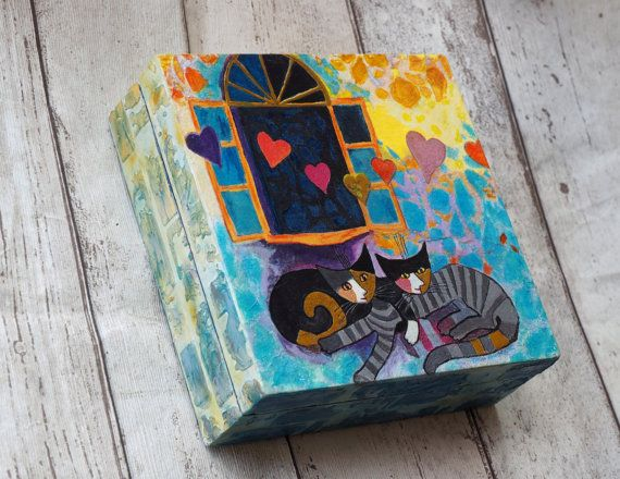 A solid vintage wood box decorated by me by decoupage technique and inspired by Rosina Wachtmeister renown cats. It is perfect for keeping your
