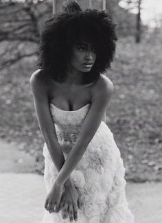 Sexy Afro with loose curls & full fringe