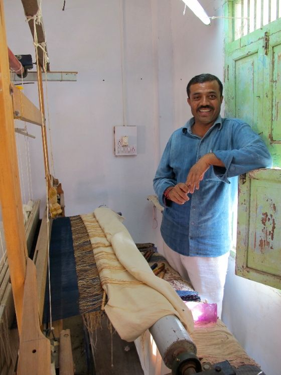This is Shamjibhai, master weaver and founder of Vankar Vishram Valji weavers in Bhuj, Gujarat.  He weaves the Desi Blankets for Stitch by Stitch. Shamji trains and employs local villagers in traditional weaving techniques at his workshop. http://stitchbystitch.eu/blog/2013/11/6/visit-to-a-gujarati-master-weaver