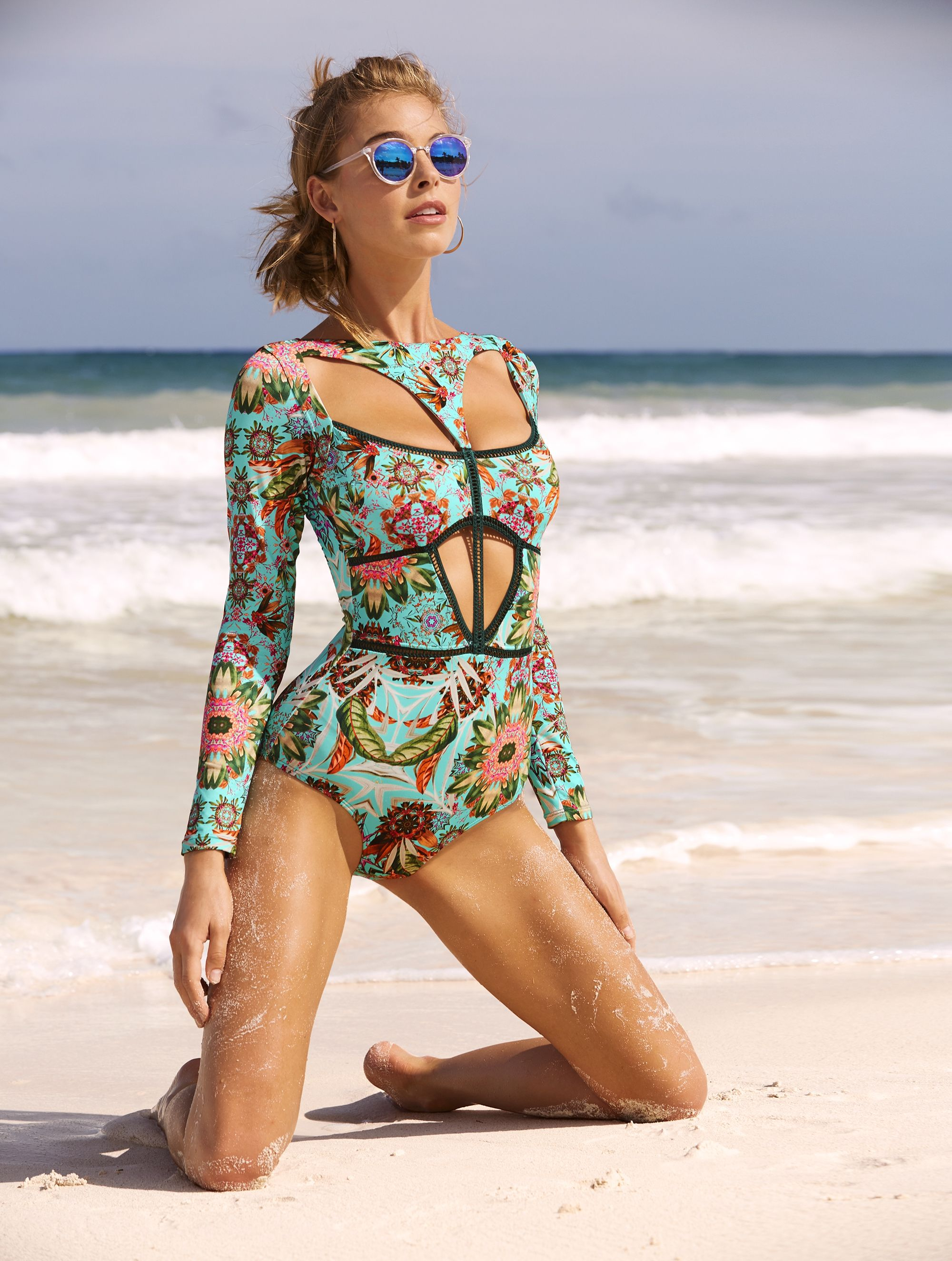 7cae5791bc0 Spring Swimwear | Women's Amazonia Long Sleeve One Piece Swimsuit by Boston  Proper. Turn heads in these bright colors and bold cutouts.