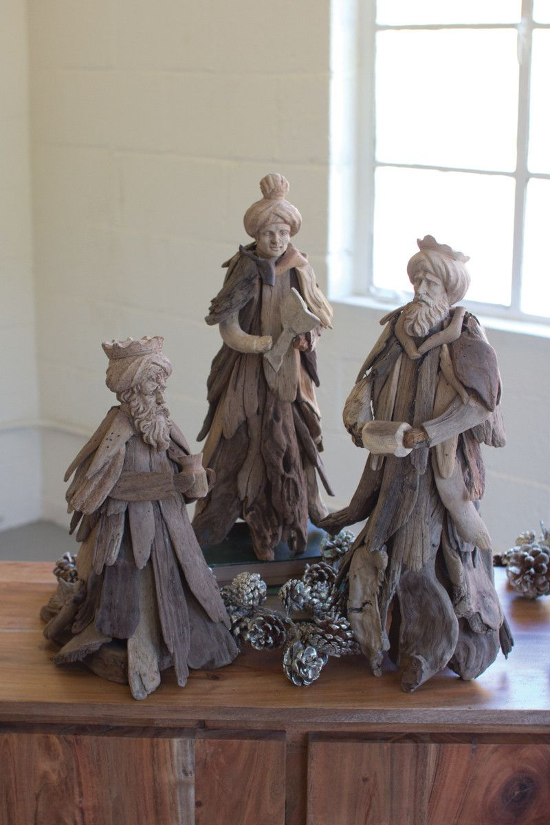 """These three wise men feature driftwood bodies and carved wooden heads, providing a charming folk art aesthetic. Display them alone or add them to your own nativity for an eclectic mix of textures this Christmas season. largest 8"""" x 6"""" x 18""""t"""