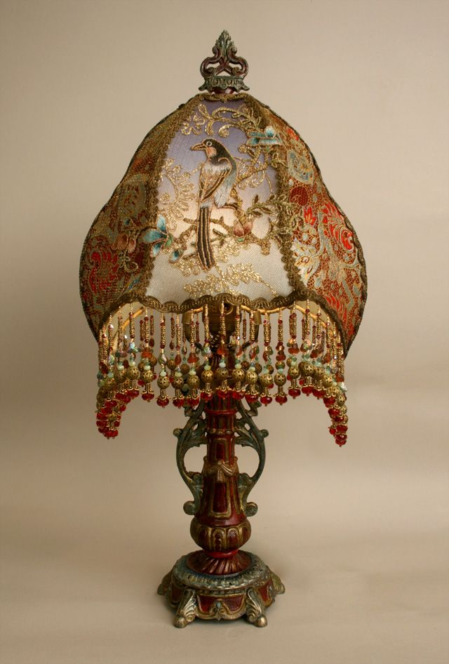 Ornate, petite hand painted antique table lamp holds an exotic Victorian  bird lampshade with incredible