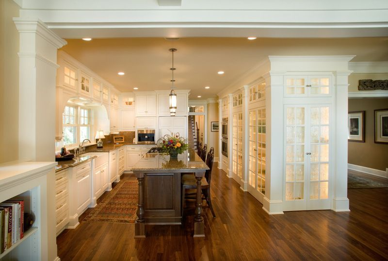 love the frosted glass walls of the pantry with lots of light coming through and pops of color of items inside