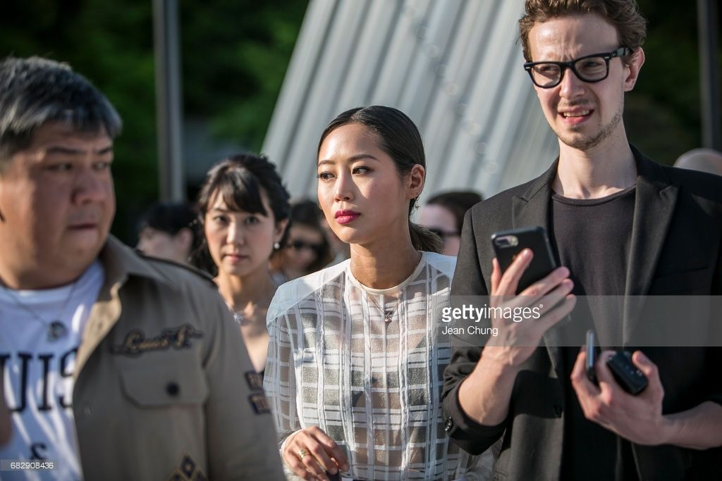 Aimee Song, center, attends the Louis Vuitton Resort 2018 show at the Miho Museum on May 14, 2017 in Koka, Japan.