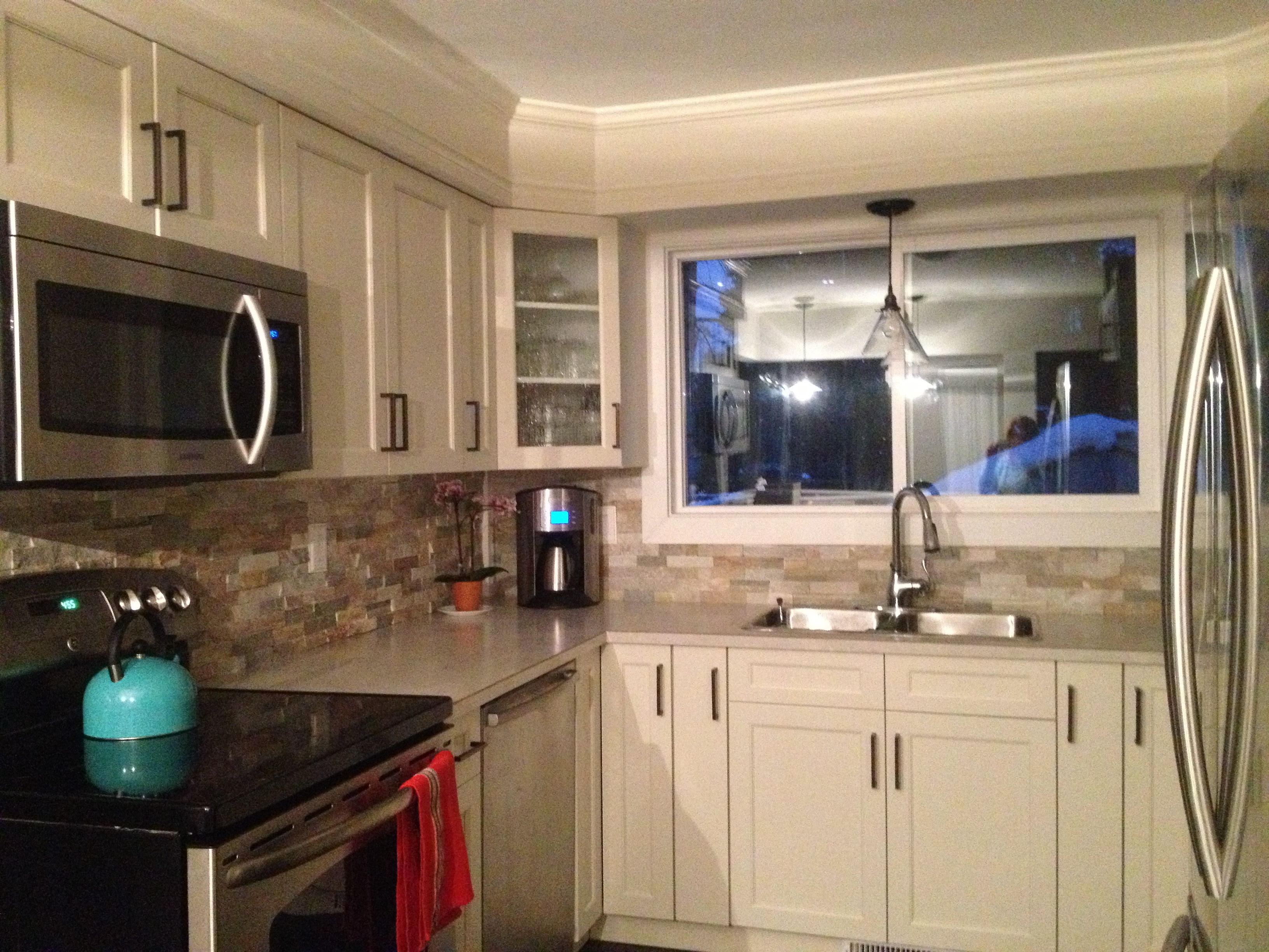 antique white kitchen with brushed bronze pulls and handles dark
