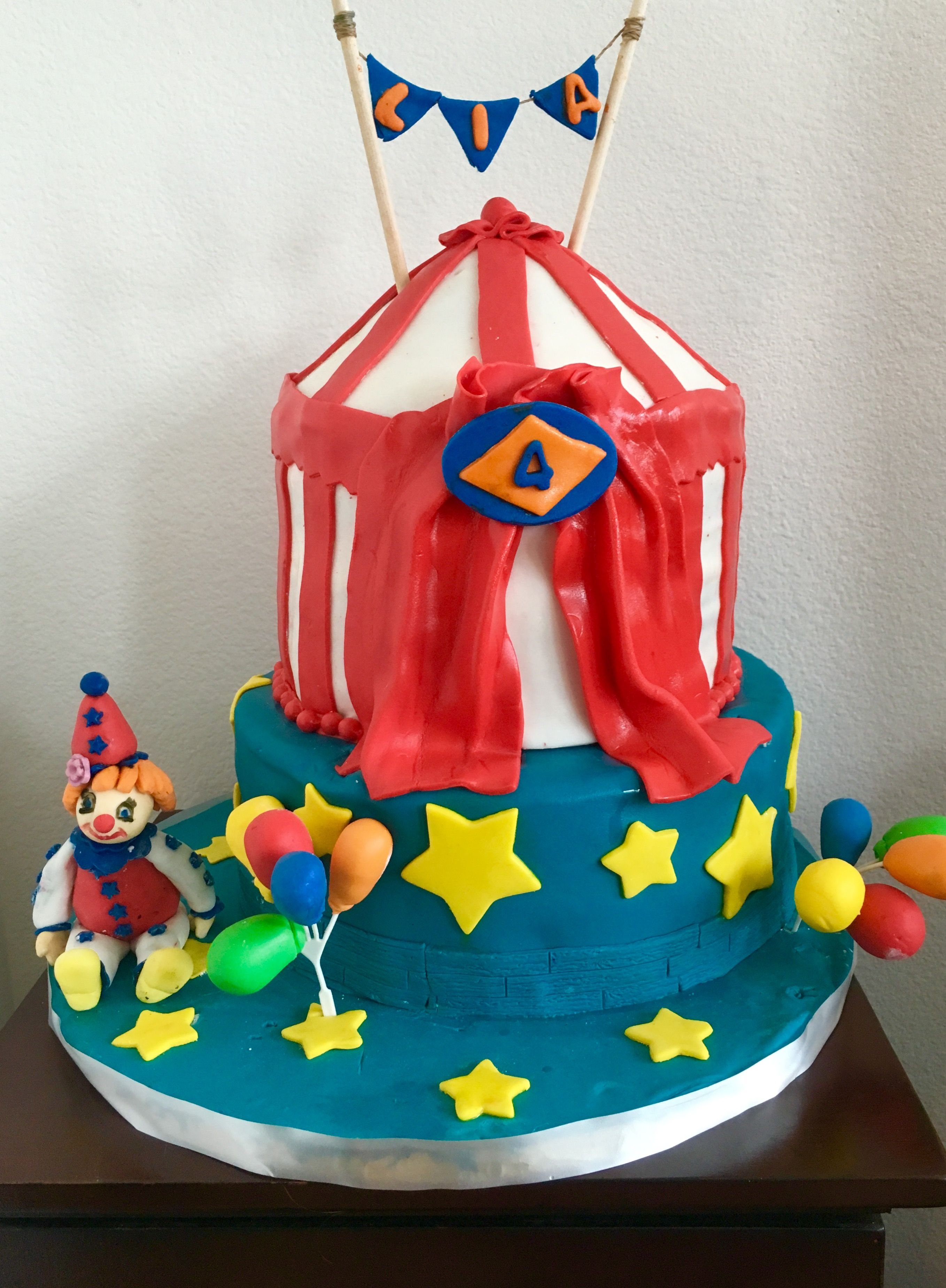 Circus themed birthday cake Complete with hand made clown balloons