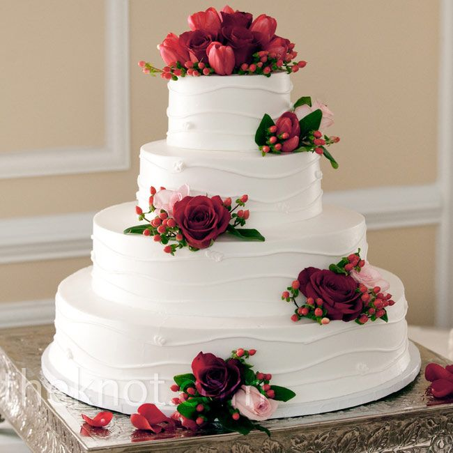 red decorated wedding cakes fresh roses and tulips decorated each tier of the 19121