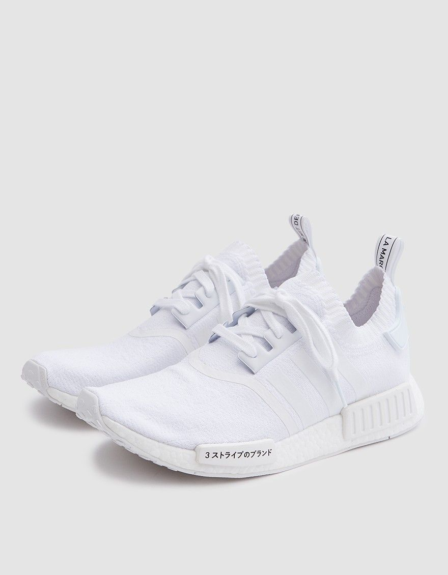 693de16ec Modern runner from Adidas in Triple White. All white color scheme.  Sock-like construction. Lace-up front with flat woven laces.