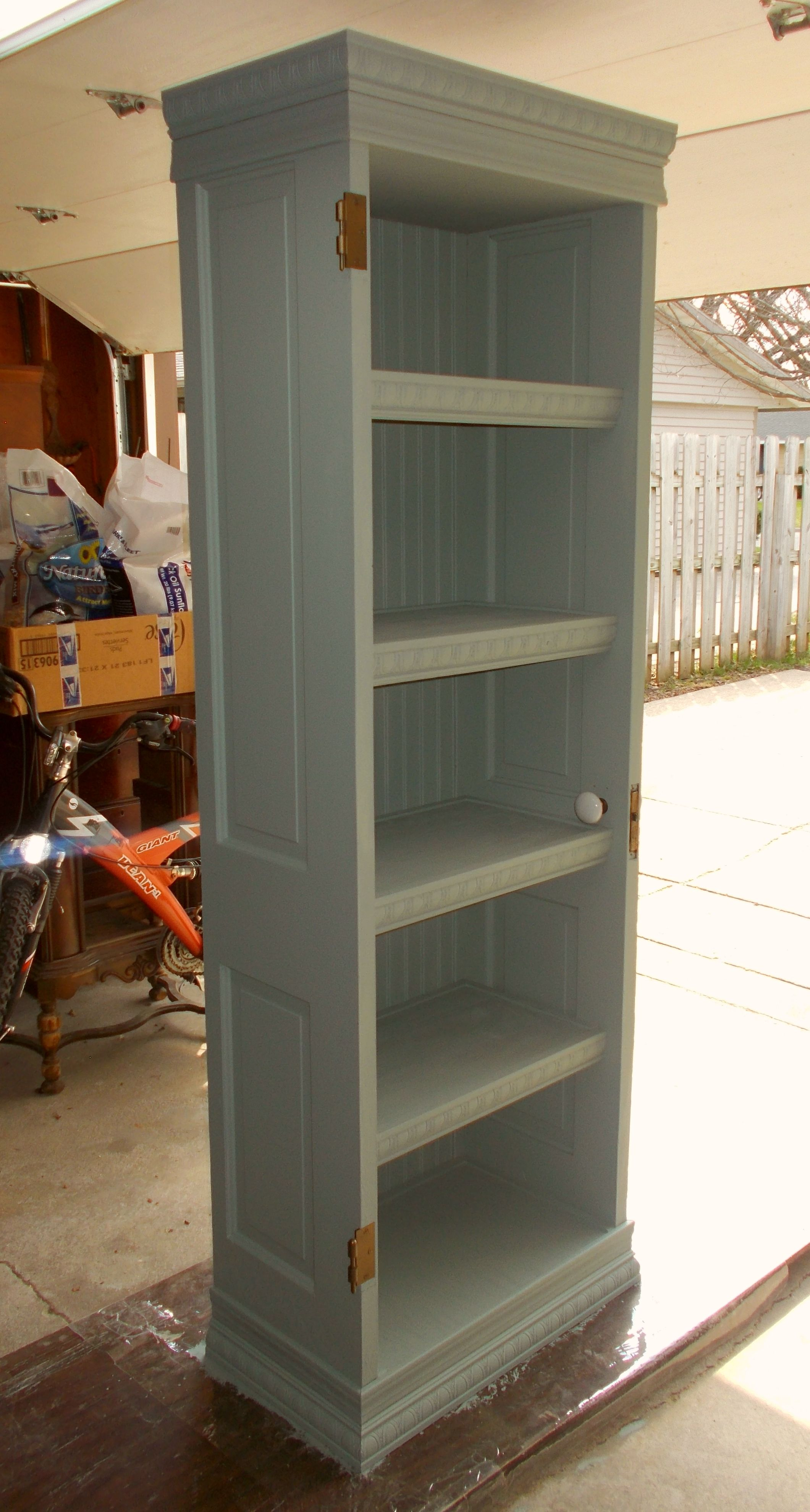another old farm door repurposed into bookcase Farm