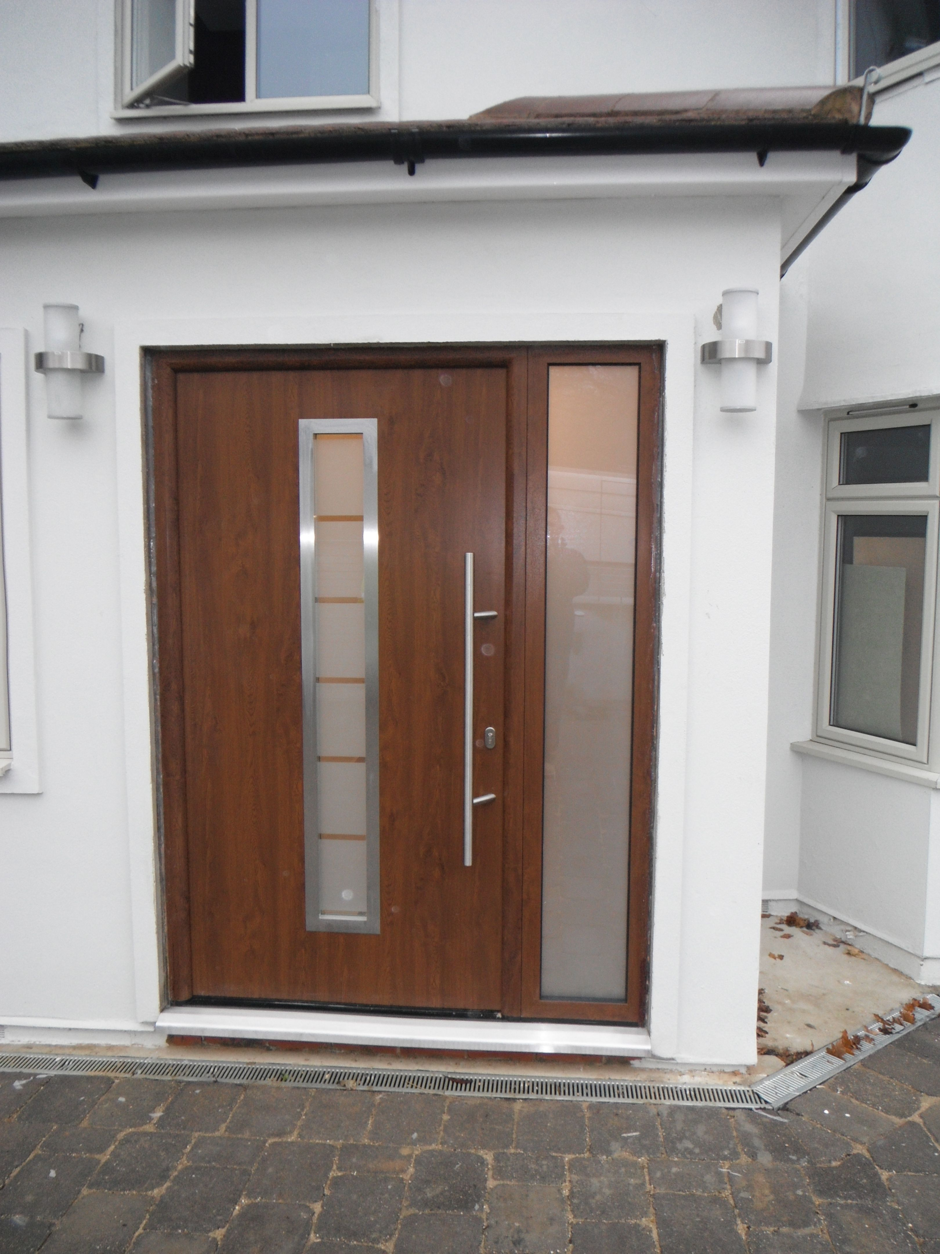 Doors and sidelights matching window on front and black onduline roof - Hormann Steel Thermopro Tps 700 In Dark Oak Decograin Finish Entrance Doorsfront