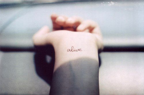 """get """"alive"""" on your wrist in your own handwriting  in white ink  great meaning to me"""