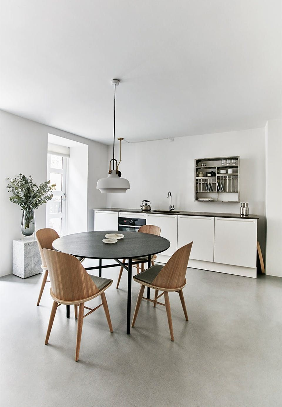 Kitchen and dining area in one bright and open with a minimalistic