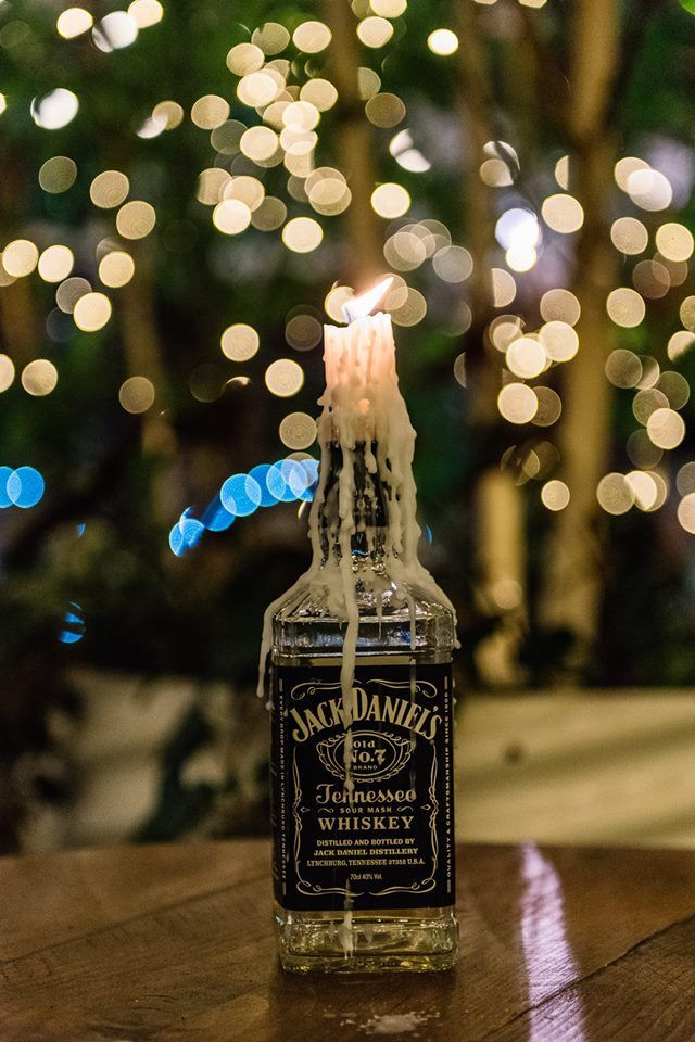 Photo of Jack Daniels Whiskey Bottle candle holder centerpiece for a wedding 2016 in Th …
