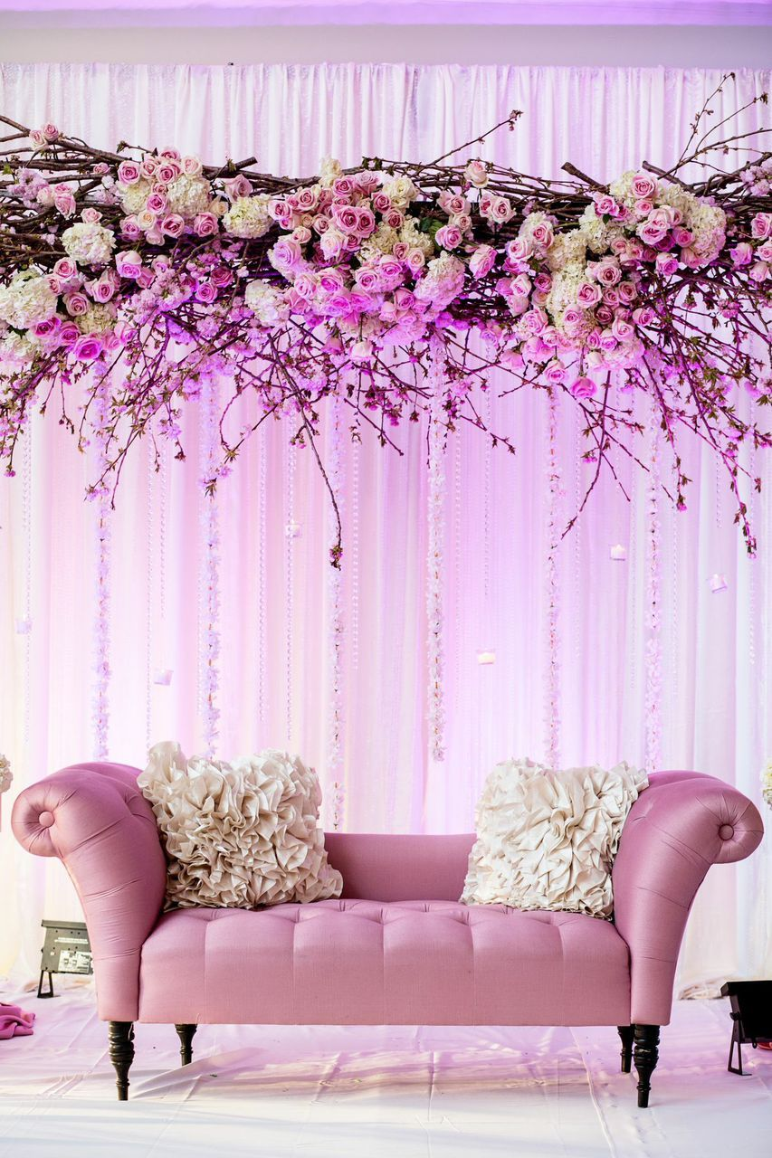 Beautiful couple stage in a cherry blossom theme | Bijal and Amish's Indian cherry blossom wedding | See the full wedding: http://www.xaazablog.com/romantic-cherry-blossom-wedding-bijal-amish/ | Photography: Salwa Photography | Decor: Design House Decor