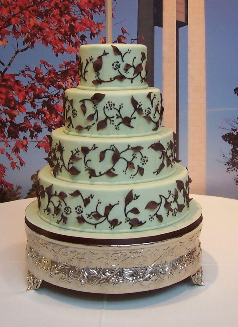 Mint green wedding cake with chocolate brown vine ...