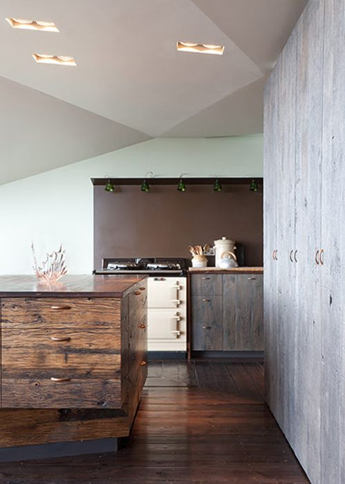 amazing raw wood cabinets. i would change the brown paint though.