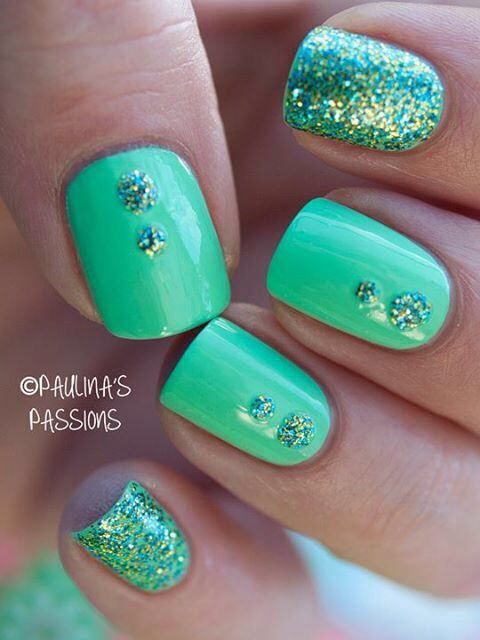 Green nails with glitter accents
