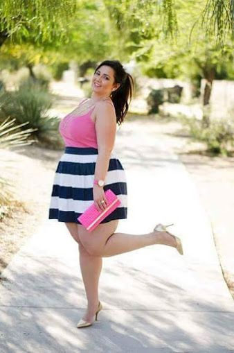 Cute BBW in a pink miniskirt