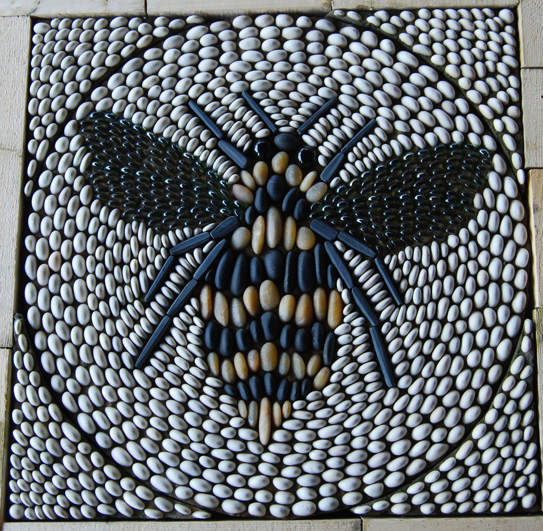 Stunning bee mosaic design used as a garden feature by for Mosaic landscape design